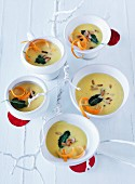 Turnip soup with pine nuts, shredded carrot and sage