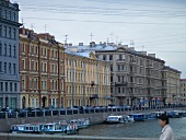 View of buildings and Griboyedov Canal with boats in St. Petersburg, Russia