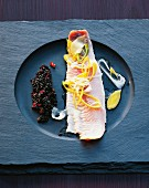 Whitefish fillet with caviar lentils
