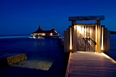 Illuminated dock huts on Dhigufinolhu island, Maldives