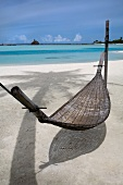 View of hammock and sea in Dhigufinolhu Island, Maldives