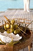 Small coconut bunches wooden table in Dhigufinolhu Island, Maldives