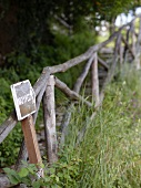 Footpath signpost and wooden fence on Pelion Mountain, Eastern Magnesia, Greece