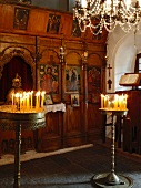Lit candles in church on Pelion Mountain, Eastern Magnesia, Greece
