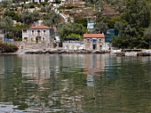 View of fishing village on lake in Eastern Magnesia, Greece