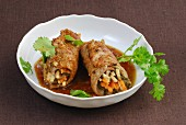 Stir-fried veal rolls with a vegetable filling, coriander and sauce