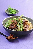 Duck breast on sesame seed noodles with Romanesco broccoli and mange tout