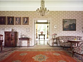 Entrance of living room with chandelier and carpet in Rieseby, Germany