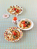 Tomaten-Risotto mit Calamaretti und Salbei