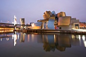 View of Guggenheim Museum on Nervion River at evening, Bilbao, Basque Country, Spain