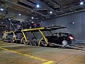 Cars on transporter in BMW World, Munich, Germany