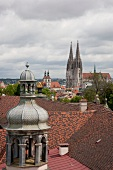 Roofs of houses overlooking exterior of Neupfarr church in Regensburg, Germany