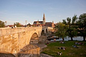 View of Holy Trinity Church and stone bridge in Regensburg, Bavaria, Germany