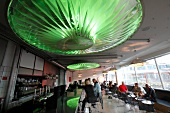 People at Karriere Bar with green lamps on ceiling, Copenhagen, Denmark