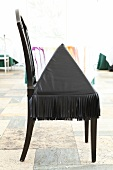 Black pyramid chair with fringe in Mielcke and Hurtigkarl, Copenhagen, Denmark
