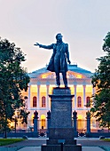 Statue and facade of Pushkin Memorial Museum at dusk in Saint Petersburg, Russia