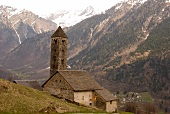 View of mountain range and San Carlo Church in Ticino, Switzerland