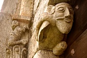 Stone face of mythical creatures in Church of San Nicola, Ticino, Switzerland