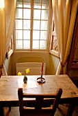 Table and chair in front of window in room of hotel Palazzo Gamboni, Ticino, Switzerland