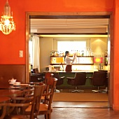 Bar waitress working at bar counter at Hotel Haus Hirt lit, Austria