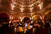People dining at restaurant with insulated dome light, Berlin, Germany