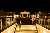 People at Brandenburg Gate and Pariser Platz at night, Berlin, blurred motion