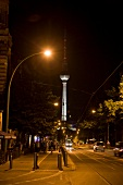 View of Oranienburger Strasse and TV tower at night, Berlin, Germany