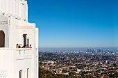 Tourist looking at cityscape from balcony, Los Angeles, California, USA