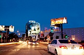 Illuminated city at night with cars on road, Los Angeles, California, USA