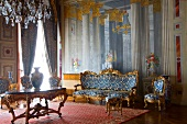 Room in Dolmabahce Palace with vases, crystal chandeliers and sofas in Istanbul, Turkey