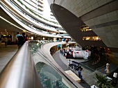 People at futuristic architectured Kanyon shopping mall in Istanbul, Turkey