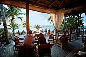 Three women sitting in Little Palm Island cafe near beach, Florida, USA