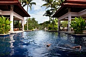 View of banyan tree villas pool palms located in luxury hotel in Phuket, Thailand