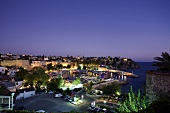 Elevated view of harbour and city at night in Antalya, Turkey