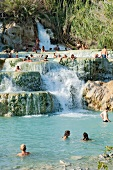 People bathing in the thermal springs of Saturnia in Tuscany, Italy