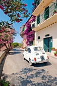 View of car driving through narrow streets in Capoliveri, Elba, Italy