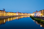 View of illuminated Santa Maria Della Spina on the Arno river, Pisa, Italy