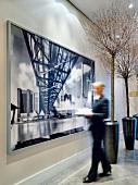 Waitress near architectural frame at the Ritz-Carlton, Wolfsburg, Germany, blurred motion