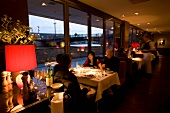 People dinning at Grill Royal restaurant, Berlin, Germany