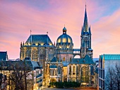 Illuminated view of Aachen Cathedral at dusk, Aachen, Germany