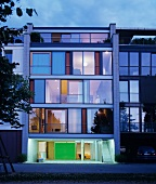 Facade of modern town house at dusk with garden in Karlsruhe, Germany
