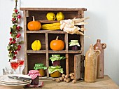 A sideboard decorated for Thanksgiving
