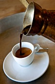 Close-up of cup being filled with coffee