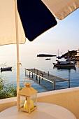 Porto Loutro hotel terrace overlooking bay boats in Crete, Greece