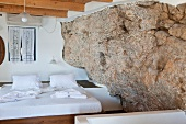 Bedroom with rock wall of Hotel Porto in Loutro, Crete, Greece