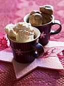 Coconut macaroons and chocolate macaroons in cups