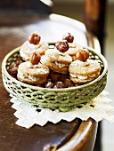 Mozartkrapfen (sandwich biscuits with a cream filling and hazelnuts)