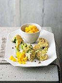 Fried broccoli with sesame and a mango dip