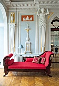 View of red sofa in hall of Castle Gaussig, Saxony, Germany