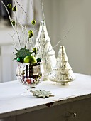 Christmas decorations with twigs, baubles and silver trees